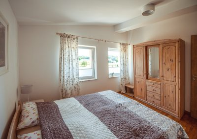 Schlafzimmer 2 | FeWo HERZENSLUST | Ostsee Ferienwohnungen in Büttelkow